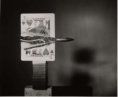 Bullet ripping through Jack of Hearts. High speed photography by MIT's Harold (Doc) Edgerton.