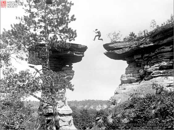 """Leaping the Chasm"" (1886) by Ashley Bennett, son of photographer Henry Hamilton Bennett, jumping to ""Stand Rock"". See www.wisconsinhistory.org"